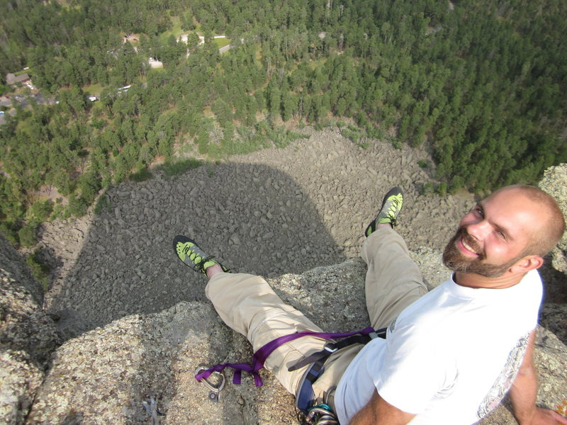On the summit, feet dangling over the west face. Photo taken in the morning.