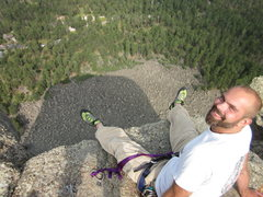 Rock Climbing Photo: On the summit, feet dangling over the west face. P...