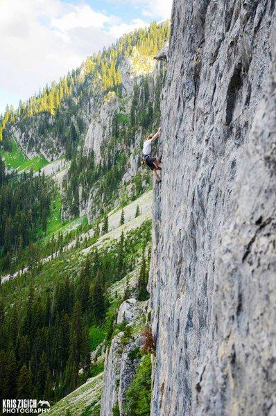 Evan Mathews nearing the top of Summer Blues <br> Photo: Kris Zigich