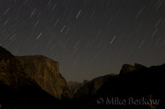 El Cap and the Yosemite Valley lit by moonlight.