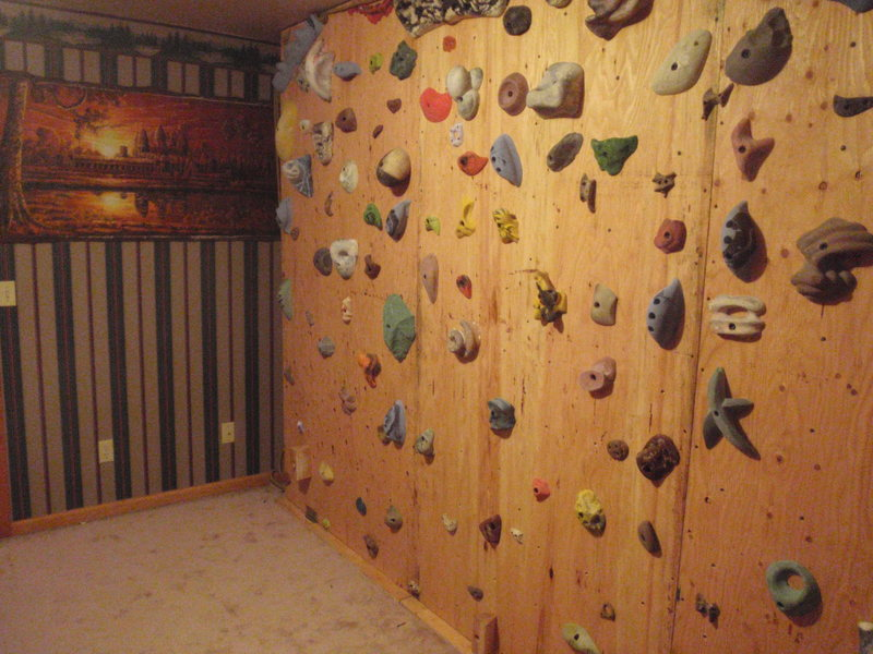 The wall can swing from vertical to 60 degrees overhanging.  There are three ropes attached to the top of the wall that are in line with the hinges at the base.  This transfers the load through the structure. Even on the most dynamic moves there is no wall flex.