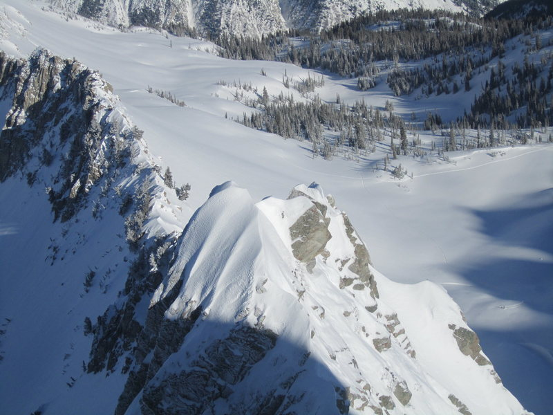 Majestic snow-topped spires seen from a vantage point enjoyed only by those who venture the ridge.