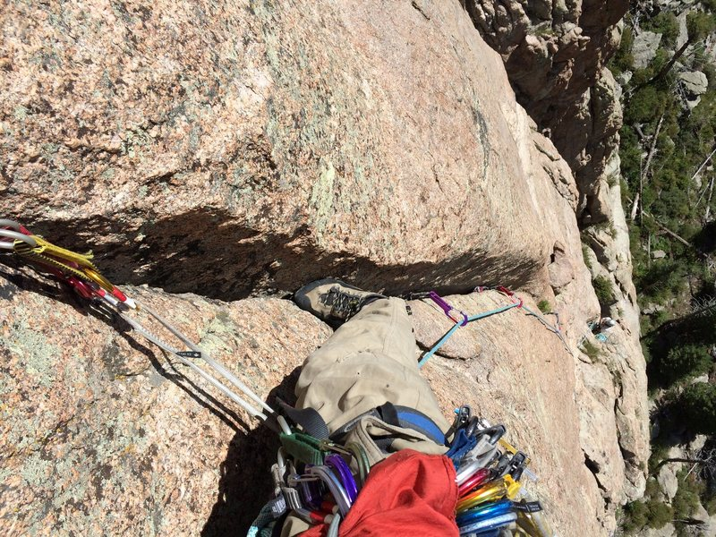 Recommended variation on P2 (as described here) is to layback the first stuff as usual but then head up and slightly right to the bottom of this splitter crack. 5.9 on the Rossiter topo, but it goes easy for Lumpy 9. As it fades, traverse straight left (5.8 face) to the bolts.