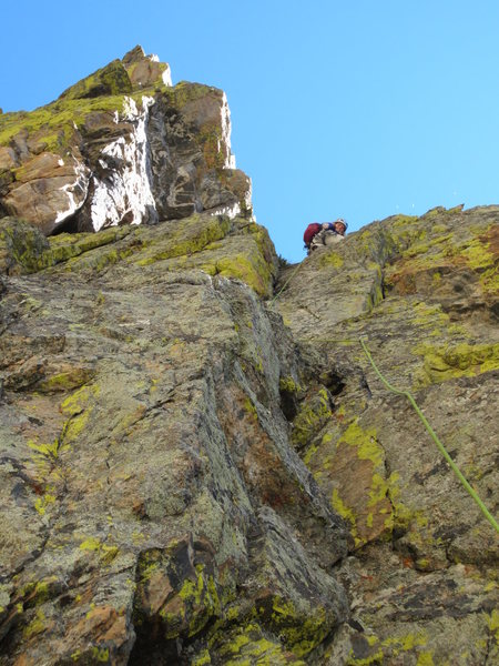 Sonya finding a nice crack up the south face for pitch 4.