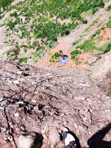 Looking down from the first major ledge before anchors after clipping 7th bolt.