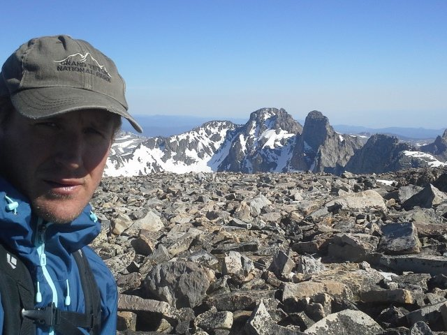 Tom on Cloud Peak, Bighorn Mtns, WY.  Blacktooth and Mount Woolsey in the background.