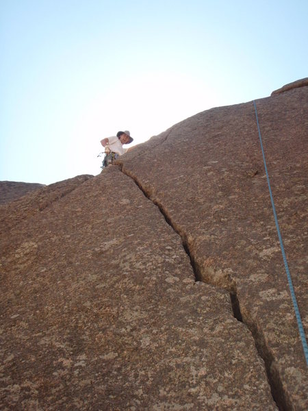 Kyle, on the arete while cleaning the route!