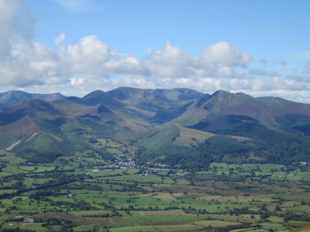 View SW from Skiddaw Hike towards Grisdale Pike and Causey Pike .Village of Braithwaite below.