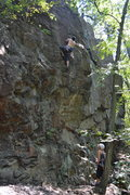 Rock Climbing Photo: Moving out onto the face for the crux.