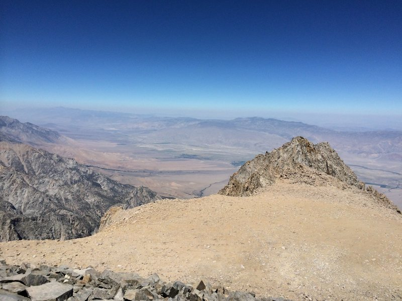 Looking back across the summit plateau from the main summit to the West Horn.