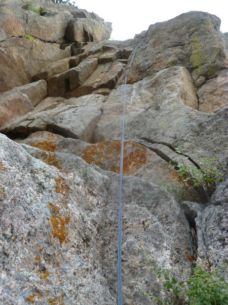 The route is likely the dihedral to the left of the rope.  Where the rope is there is a fun crack.