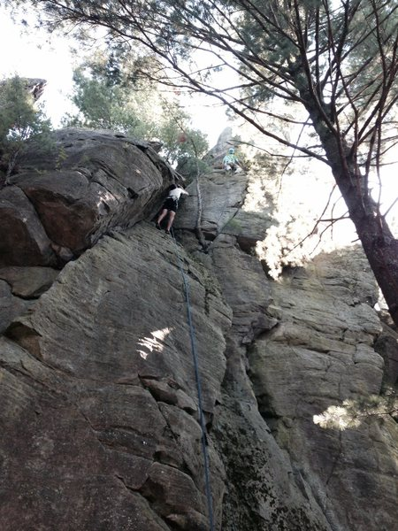 Doug, in the juggy section above the finger crack. The lower half of the climb is hidden from view.<br> <br> Photo by Teresa