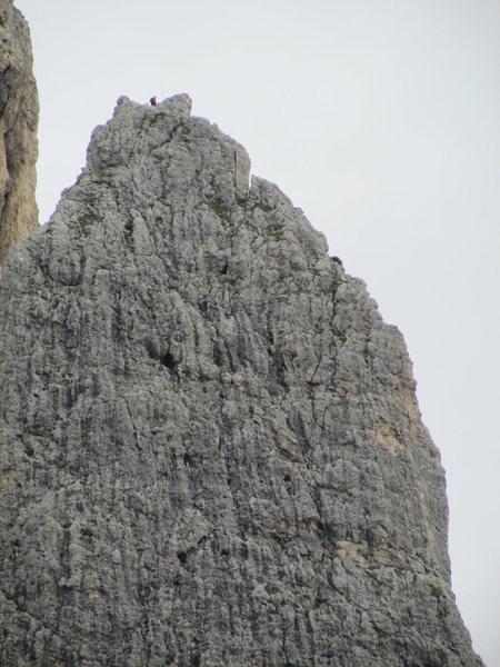 Solitary climber atop Kleiner Falzaregoturm.