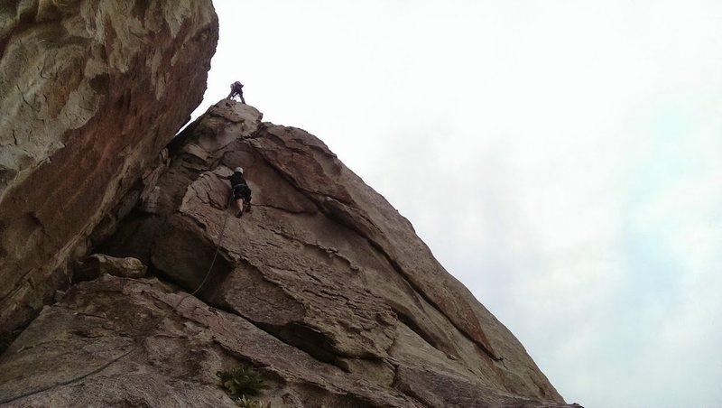 Kelli climbing the last pitch to the summit! Matt on belay.