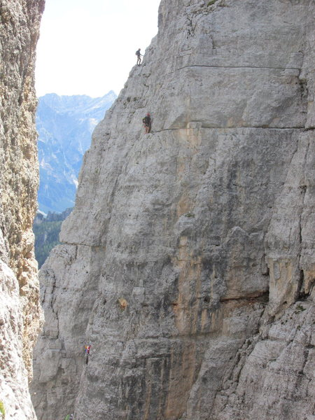 Unknown climbers on Torre Lusy (skyline), and Torre Barancio.