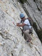 Rock Climbing Photo: The short, traversing P3. Rob in good form.