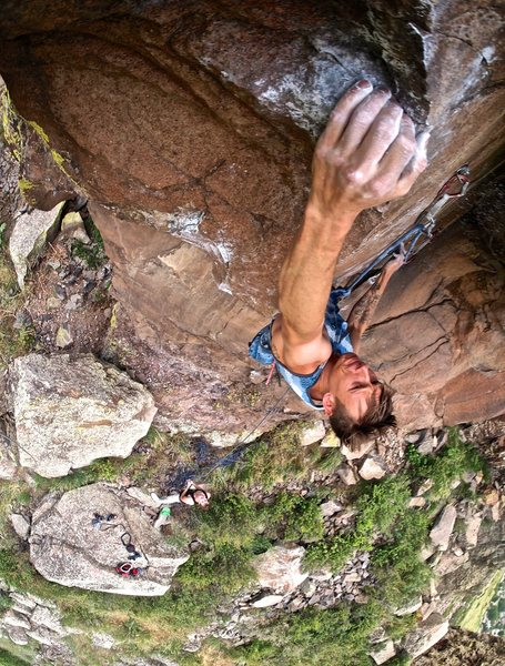 Matt Lloyd climbing into the crux.