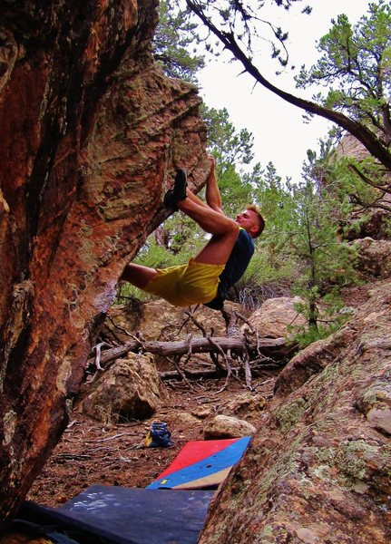 Rock Climbing Photo: Setting the heel hook on Schlong.