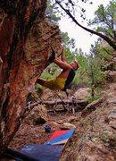 Rock Climbing Photo: Setting the heel hook on Schlong.