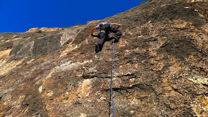 Climber on the crux of Chief Joseph.
