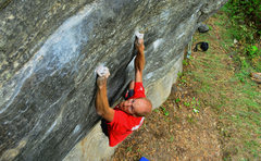 JBone on the crux of Weapon of Choice at the Gun Locker Wall