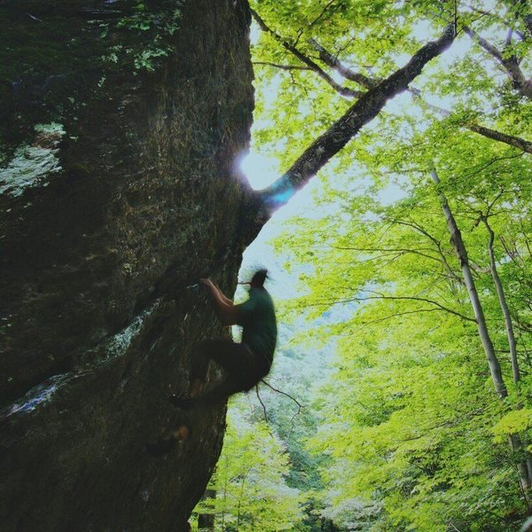 Myself climbing on The Roots boulder, Smugglers Notch, VT.<br> Very unique boulder!