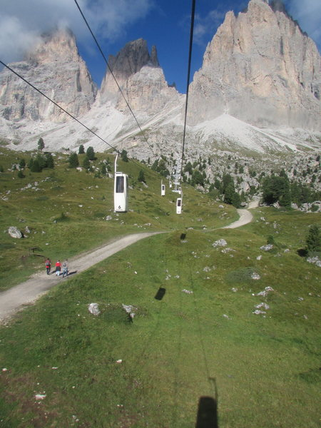 Getting to Langkofelscharte (Forcella Sassolungo) is an easy choice; either take the single person Gondola, or trudge up an extremely steep slope on a rocky trail for several hours.