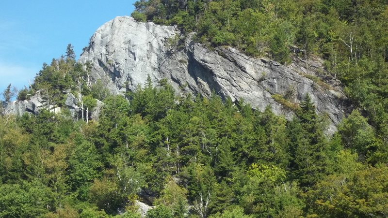 "The cliff, well known routes are on the ""white ish "" left side bulge."