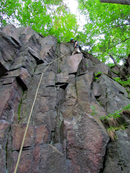 Colin Loher on the most obvious ledge of the route. All but the very bottom and top of the route is in view.