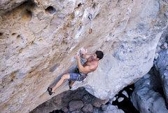 Climber Joe Wysznski carefully sets the crux undercling on Urban Struggle.