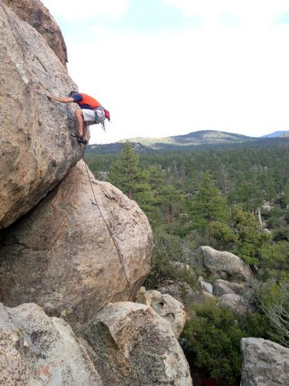 Chris at the crux on Supercalibelgolistic (5.9), Holcomb Valley Pinnacles