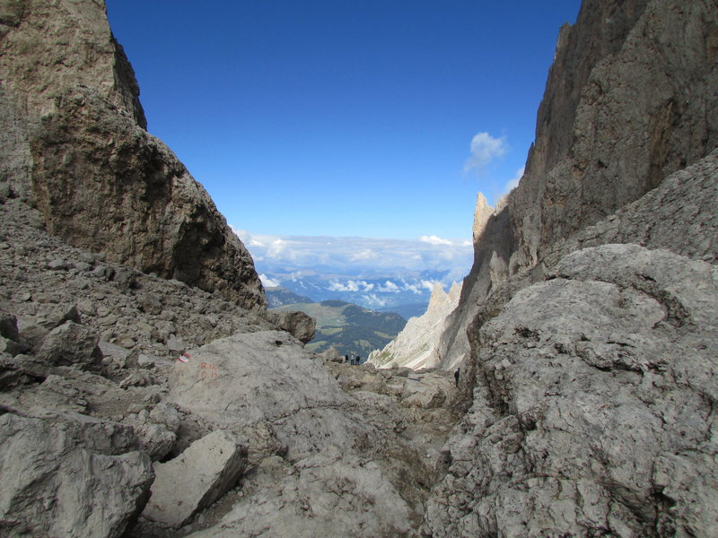 There's a fairly good trail system in the Dolomites, and a good but steep trail ascends from the Comici Hut to the Langkofelscharte. This view is looking down the valley towards Wolkenstein (Selva).
