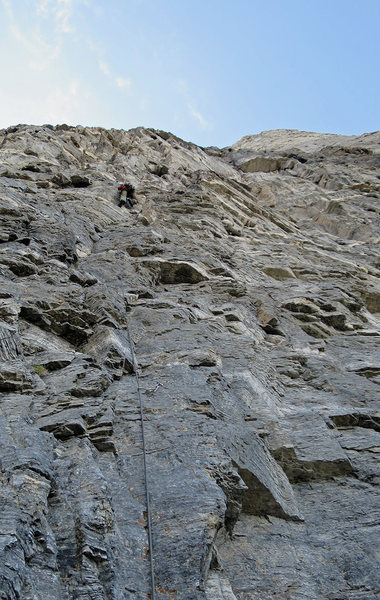 Darren midway up the first pitch. The lowest bolt visible is the first bolt of the route.