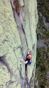 Steve setting up for the crux move into the fine crack on Venus Flytrap