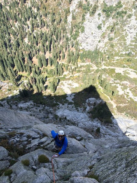 Rob Beno following P5 of the Timex Route with the shadow of the Watchtower looming below
