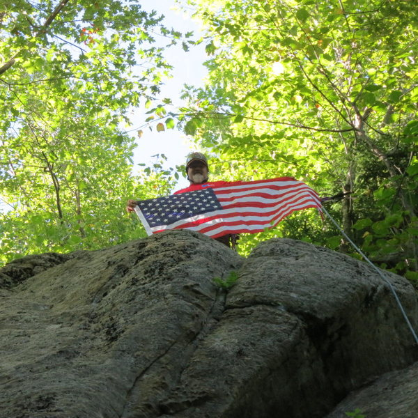 First ascensionist Todd Paris flying the colors atop A Peney For Your Freedom.  The flag will proudly fly at my home in Massachusetts.