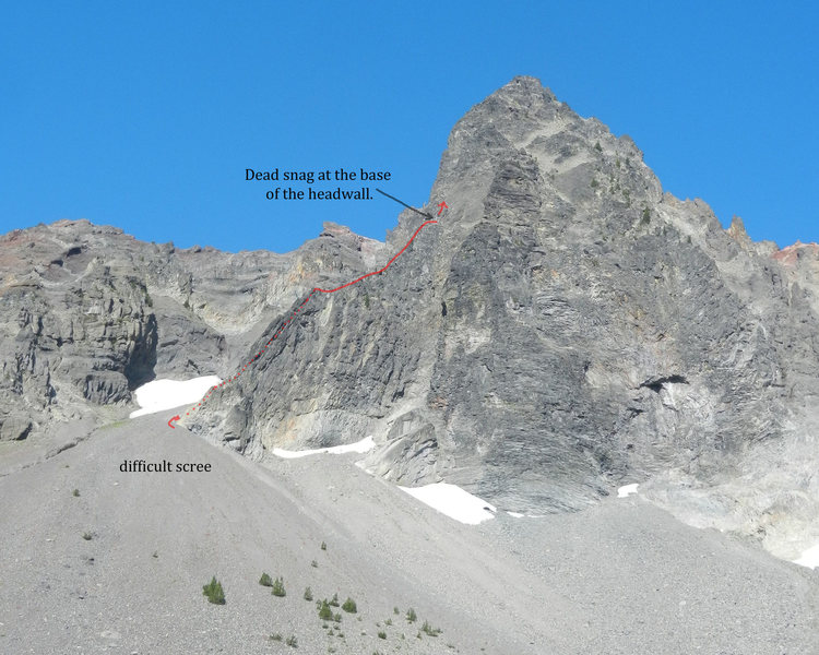 The route as seen from the basin due east of the mountain. The starting fun slab is just around the corner and behind the lower part of the spur. The ridge just to the right of the SE Spur is the E Buttress.