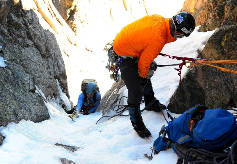 Elise makes her way up through the ice bulge crux.