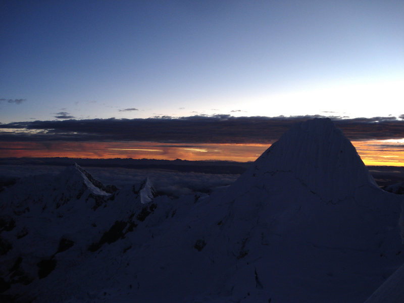 Sunrise behind Alpamayo, seen from the route on Quitaraju.