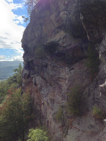 The Main Cliff with someone climbing Peanut Man.
