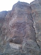 The route climbs the face to the left of the crack