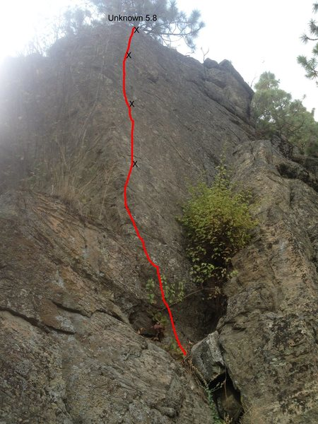 Another 4 bolt route found up on the hill behind the secondary face.  This route rides the arête, but is a little dirty.