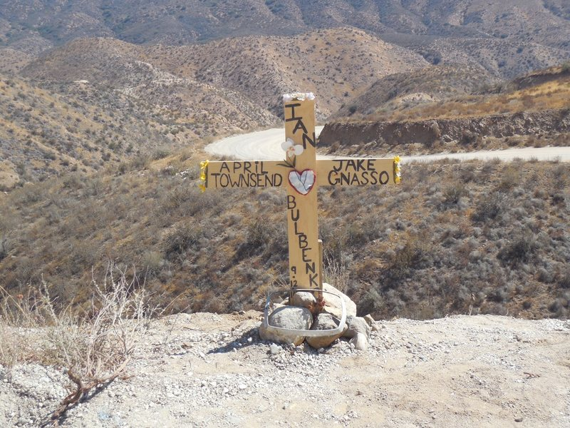 A cross has appeared on the east side of Rush Canyon Road, on the way to Texas Canyon, honoring Jake Gnasso, Ian Bulbenko, and April Townsend.  09-12-14