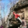 James on unknown V2. On the trail just before reaching the River Boulder, this will be on your right. Start on block on right, follow chalked holds up and left. Move to left hand in picture can be dynamic for some, depending on height/reach. From there, it get's spicy. Bring more than one pad and have a spotter. Top out is a mantle high off the deck. Do not climb wet rock here.