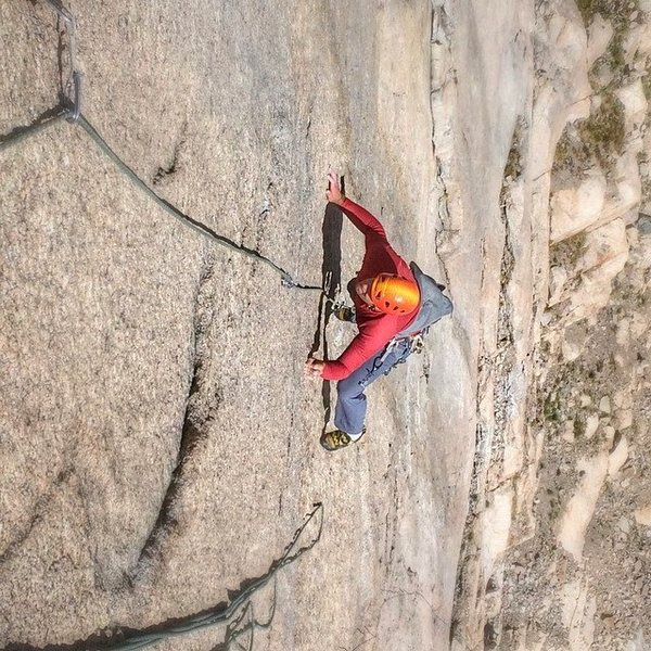 Ben Collett pawing in the crux.