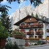 Cortina d'Ampezzo with the Punta Fiames, Punta della Croce, and Campanile Dimai rising behind the Hotel.