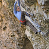 Ed Strang cranks the low crux on Lung Fish (5.14).