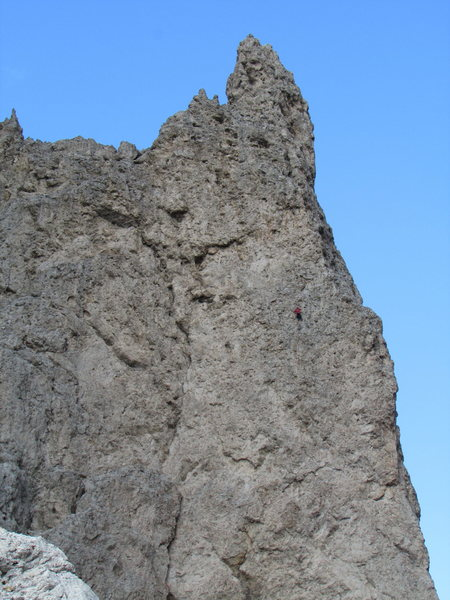 A red-clad climber on the Langkofelscharte face of Dito di Dio.