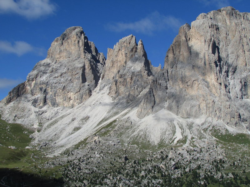 One of the most famous views in the Dolomites@SEMICOLON@ the Langkofel Group. Peaks shown, left to right, are Grohmannspitze, Fuenffingerspitze, and the Langkofel main peak.