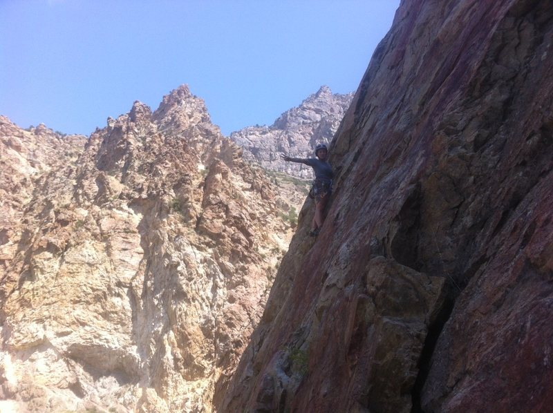 Leading the mantle, gets a little empty just above this, very fun, very scenic climb